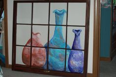 I have a penchant for pots!  This is a painting on an old window looking through at the pots.