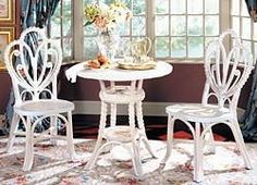 Wicker Tea Table Set: Victorian Style  -The Wicker Victorian Tea Table and Chairs set are beautifully detailed with spiral design and classic wicker appeal. -Available in White or White Wash Finish -Measurements: Table: 34