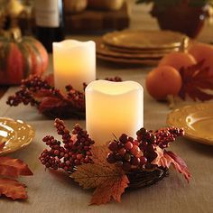 Our Harvest Wreath Pillar Centerpiece is the perfect addition to any fall table setting or accent table. With a set of flameless candles and seasonal wreaths, this stylish duo brings a festive and warm touch to any décor.