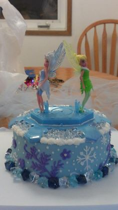 This is what I came up with for Jaelle's party. I used marshmallow fondant and fake jewels at the bottom and fill-in for the top. Tinkerbell and Periwinkle Secret of the Wings birthday cake!