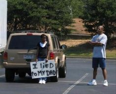 parenting done right, a kid holds a sign