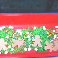 Gingerbread Sensory Table, pom poms, green pasta bow ties... cute!