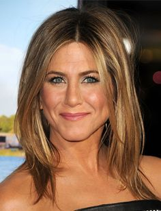 Not ready to go full-on blonde? Follow Jennifer Aniston's lead by playing with a chestnut brown and accenting with golden highlights. It's also a great combo for that summer glow that will carry on into the cooler months!
