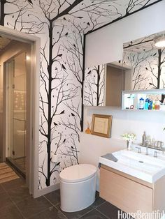 "Cavern Home's Blackbird wallpaper is a graphic counterpoint — that seems to ""grow"" on the ceiling, too."