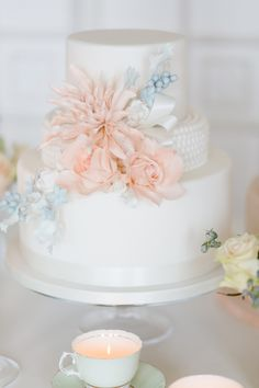 Blush pink wedding cake with pale blue details #weddingcake #cake #wedding #blushpink #blushpinkwedding