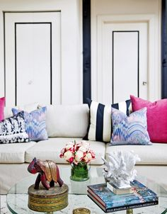 Don't be afraid to get girly with a nautical theme—hot pink is the perfect complement to navy blue. door, white interiors