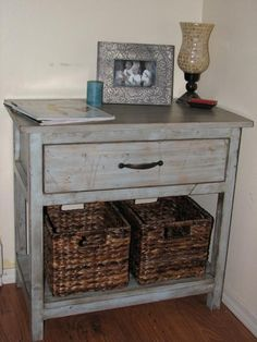 Blue spray paint distressed with stain.  Beautiful finish!  Farmhouse Bedside Table   Do It Yourself Home Projects from Ana White