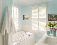 Aqua and white bathroom.