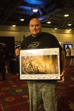This lucky QuakeCon 2014 attendee won a signed ESO Aldmeri Dominion lithograph at the Dallas Pets Alive booth.