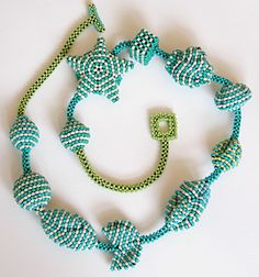 Wild shapes peyote, brick, & right-angle weave necklace.