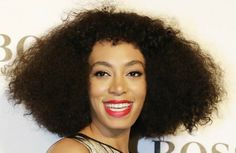 Solange pairs her natural hair with shiny scarlet lips at the opening of the Hugo Boss store in Hong Kong.