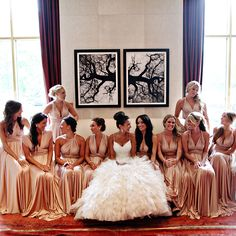 OBSESSED. Mallorie's 10 bridesmaids wore floor-length, rosewater-hued TwoBirds dresses, which they wrapped in various ways, creating the illusion that each was wearing a different dress.