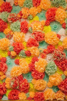 paper pom and pinwheel backdrop, photo by Heidi Benjamin http://ruffledblog.com/revolution-hall-wedding #weddingideas #backdrops