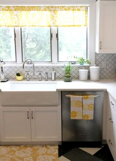 Love this backsplash.  Lantern tile backsplash. Kitchen of Christine Soccio via Design Sponge