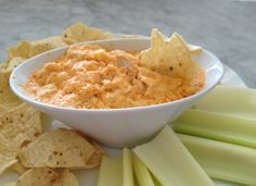 Slow Cooker Buffalo Cheesy Chicken Dip - Go-To Dish for potlucks and social gatherings!  www.GetCrocked.com