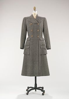 Coat Mainbocher  (American, 1890–1976) Date: 1946 Culture: American Medium: wool Dimensions: Length at CB: 47 1/2 in. (120.7 cm) Credit Line: Brooklyn Museum Costume Collection at The Metropolitan Museum of Art, Gift of the Brooklyn Museum, 2009; Gift of Arturo and Paul Peralta-Ramos, 1954 Accession Number: 2009.300.169 This artwork is not on display