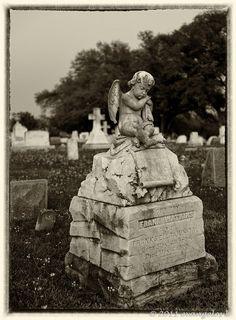 #Natchez: Boy Angel Statue at Dusk   #cemetery www.visitnatchez.org