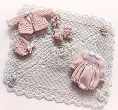 1:12th scale miniature baby clothing ... hand knitted wool sweater set, hand crocheted baby blanket, and a hand-sewn romper. Sweater is about an inch long ... Monica Roberts Collection