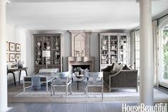 Grey living room Mary McDonald modern French country wood floors grey sofa and ottoman style bench