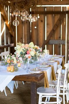 pastel gold and vintage china to create a romantic and chic wedding reception #weddingreception #tabledecor #weddingchicks http://www.weddingchicks.com/2014/01/29/shabby-chic-barn-wedding/