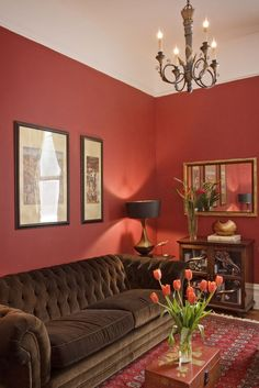 Brown and red living room - the current colors I'm trying to implement. I have a brown couch and red curtains, but need more to complete the look.