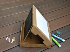 Pizza Box Easel by ikatbag; Hours of fun with the right drawing supplies and paper. There are even instructions for making an eraser that really works.  And everything folds up and gets stored away when you're done.  #Kids #Crafts #Drawing #Easel #Pizza_Box #Upcycle