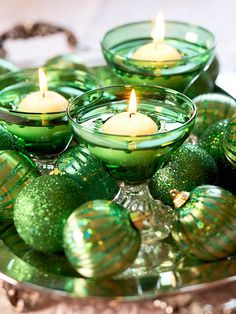 I like the idea of adding floating candles to the traditional Christmas bowl of ornaments!