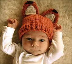 Fox hat knitting pattern. Because new babies should wear as many animal ears as possible on their clothing.
