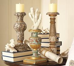 Pillar candle holders, beautiful vignette Pottery Barn -- no longer available -- inspiration candle holders, book, candlestick, candl holder, candl stick