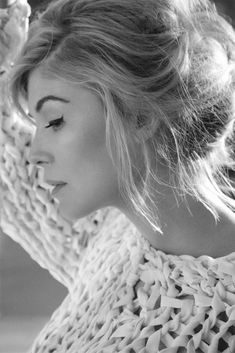 rosamund pike- love the chunky sweater, messy updo and retro eyeliner