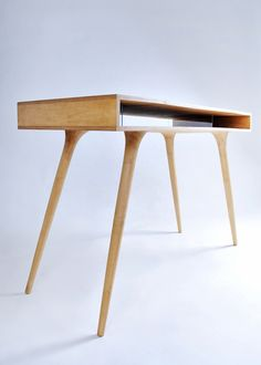 nice legs lovely desk for a small uncluttered office.
