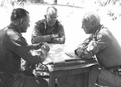 Lt. Gen. Troy Middleton, Lt. Gen. Omar Bradley, and Lt. Gen. George Patton make plans for the final drive on Messina, Sicily, 1943. Photo via Jonathan W. Jordan, author of the critically-acclaimed BROTHERS RIVALS VICTORS.