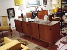 Florence Knoll credenza, by Knoll. Walnut cabinet with four sliding doors with leather pulls $1200.00