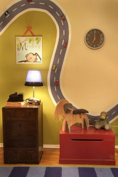 "Nursery eclectic kids.  Magnetic Paint ""road"" painted on wall, cars with magnets added to track! This is so awesome but would definitely encourage my boys to climb on all the furniture to reach the track"