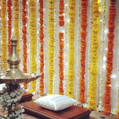 Lamp and marigolds: a traditional set up for family blessings in India.