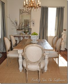 LOVE the reclaimed wood table and WANT those chairs!