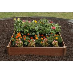 """Why work up a sweat digging, when you can put together an easy-to-assemble raised garden bed that doesn't even require tools? Made of recycled plastic and wood, this nifty 42"""" x 42"""" bed needs just 6 cubic ft. of soil, and you'll be good to grow!"""