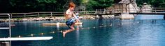 Boy jumping off diving board at beach- Mohonk  Mountain House