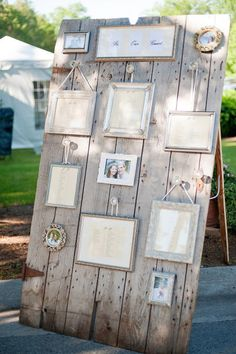 Several frames hold the alphabetical seating chart - rustic door adds charm!
