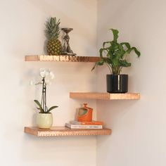 Wow, doesn't this look great? The textured floating copper shelf is hand-finished and a stunning way to display accessories in style at home.