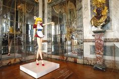 The sculpture Miss Ko2 by Japanese artist Takashi Murakami was displayed at the Chateau de Versailles in 2010.