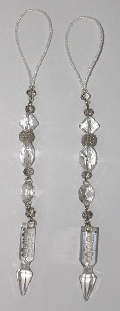 Flea-market finds are always the best inspiration, especially when they're vintage chandelier crystals. Spear crystals, and diamond-cut, flat-back crystals anchor this sparkling pair of beaded tassels. Please visit my Etsy Shop www.gmbdesignscustom.etsy.com