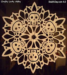 Cool idea for Day of The Dead parties. How-To: Skull Paper Snowflake