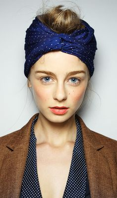 karen walker blush, coral lips, and a turban on top.