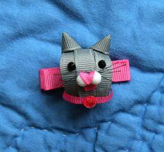 cat ribbon sculpture