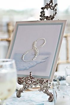 Since ill have a beach wedding,  numbers in pearls are perfect!