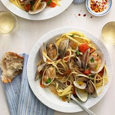 Summer tomatoes are what make this dish shine; use whatever fresh varieties you find at the market. Crusty bread may be optional, but it should be essential—once the noodles are gone, you'll want something to mop up all the leftover sauce with.