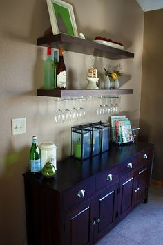Install wine glass holder underneath floating shelves!