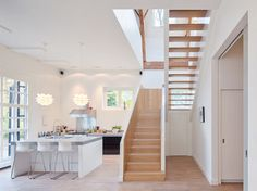 Beautiful staircase with dense base and light weight rise. Love the concept of losing the weight as you go higher.