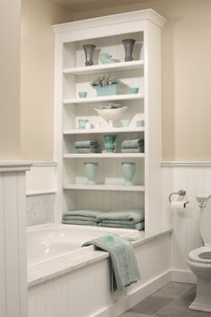 bathroom storage and ledge on tub and colors